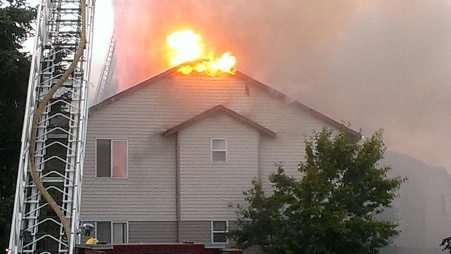 Fire spreads through the attic to the roof.