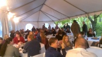 Escaping the rain during Saturday's dinner event.