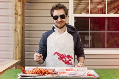 eating lobster with a lobster bib alma new brunswick canada