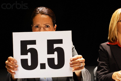 Competition Judge Holding Up 5.5 Scorecard --- Image by © Robert Michael/Corbis